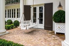 Traditional Porch with Glass panel door, exterior tile floors, Raised beds, exterior herringbone tile floors, Porch swing