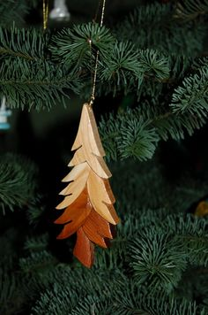 Christmas Tree Ornament Wood Carving. A Festive Miniature Work Of Art