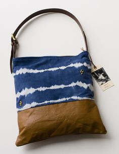 Leather and dyed canvas tote. Via MADEBYHANK
