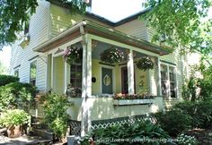 Summer Porch at Town and Country Living. Clapboard exterior is painted with Victorian colors. Hanging baskets with impatiens add additional color and cottage appeal. Cozy Cottage, Cottage Living, Cottage Homes, Cottage Style, Country Living, Farmhouse Style, Farmhouse Front, Cottage Design, Farmhouse Ideas