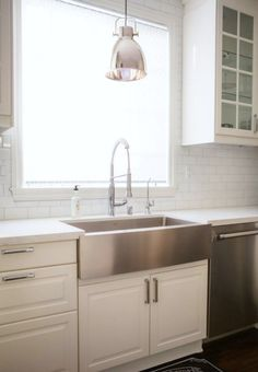 This is the setup I think, stainless steel farmhouse with commercial faucet--An IKEA Kitchen in San Diego