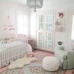 The sweetest nursery featuring Surya's Zahra rug in soft pastels (ZHA-4007). Design by @stephgjohns / Photo by @belairhome.