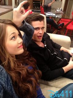 Just hanging on the couch Adam and Bree are making fun of Chase head when Bree is fingers are measuring Chase head