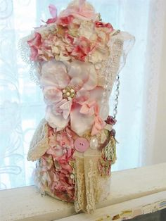 collection of vintage millinery flowers on old mannequin