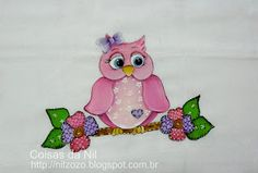 pink owl painting on a branch with flowers