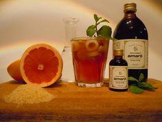 KURA MINT ,coktail analcolico ingredienti: pompelmo rosa a cubetti, foglie di menta fresca, acqua tonica, Amarò.