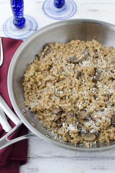 Farro Risotto! A healthy risotto that's so flavorful! Farro cooked with white wine, vegetable broth, shallots and mushrooms. Vegetarian and Vegan versions.   www.delishknowledge.com