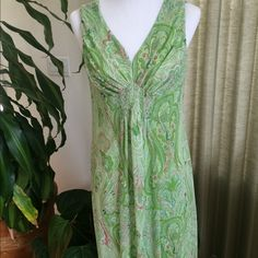 "2X Host Pick  Pretty Green Paisley Dress Beautiful sleeveless v neck dress with smocking at the bodice. Sheer fabric with green lining. Back zip closure. Length 40 inches shoulder to hem. 19"" armpit to armpit. Will fit up to about 41"" bust. Great condition. Dresses"