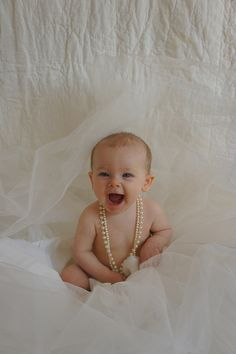 baby in wedding dress and pearls!