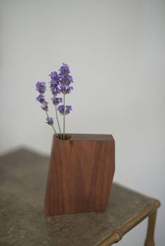 A miniature wooden vase from Boyce Studio that holds