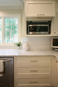 Classic white kitchen by Walker Woodworking. This open classic white kitchen allows plenty of light to reflect off the white custom cabinets. Inset Cabinets, Custom Cabinets, Kitchen Cabinets, Kitchen Appliances, Kitchen Redo, Kitchen And Bath, Classic White Kitchen, Home Organization, Organizing Ideas