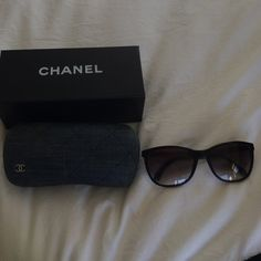 Authentic Chanel Sunglasses black These are used but I just had brand new lenses put in so NO Scratches!!!  The sides shoe wear as pictures.  I have the case and box.  The case shows wear as well.  Great slight cat eye.  These are a basic style that looks good on most faces!  Rock bottom pricing!   CHANEL Accessories Sunglasses