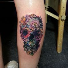 Floral skull calf tattoo