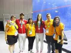 July 12 - Squash - Singles.  Canada's Shawn Delierre and Samantha Cornett pose with their bronze medals.