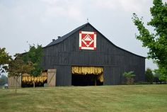 KY tobacco barn with a Quilt Square. My great Grandfather was a barn raiser in Central KY. Love barns.