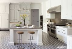 Stainless steel accents — not to mention an eye-catching floor — take designer Penny Drue Baird's pale gray pick over the top.