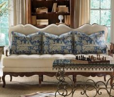 love the three pillows across the french settee...off centered coffee table is a good surprise