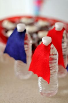 Awesome super hero party ideas. These DIY water bottle capes are so cute!