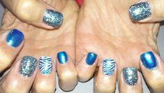 Animal Print nails!  Acrylic nails with hand painted nail art and glitter acrylic on ring fingers with gel top coat.