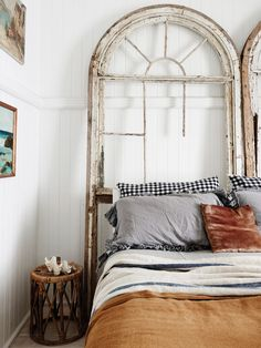 This is a very cool idea. Old window frame as decor.
