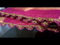 Crochet saree kuchu flower arch design with beads. This is a video tutorial on how to make crochet saree kuchu tassels, unique and exclusive design, simple and easy in just 4 . Saree Tassels Designs, Saree Kuchu Designs, Crochet Flower Tutorial, Crochet Flowers, Half Saree Lehenga, Indian Gowns Dresses, Crochet Videos, Bead Crochet, Chrochet