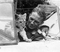 Franz von Werra, German World War II pilot with his pet lion Simba