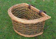 """Traditional """"D"""" shaped bike basket. Fits almost any bike and great for a trip to the market. Strong leather straps and made from very stout willows. 16.5"""" x 12"""" x 9.5"""" high - £32.50"""