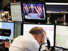 A broker reacts as new elected US President Donald Trump shows up on a television screen at the stock market in Frankfurt, Germany, Wednesday, Nov. 9, 2016.(AP Photo/Michael Probst)