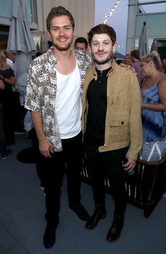 Actors Finn Jones (L) and Iwan Rheon attend the Entertainment Weekly and Marvel After Dark event at the EW Studio during Comic-Con at Hard Rock Hotel San Diego on July 21, 2017 in San Diego, California.