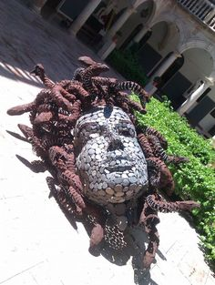 Slate stone, iron and glass #sculpture by #sculptor Manuel Garcia Calderon titled: 'Medusa, Head of love and hate (Massive stone/Metal Outdoor sculptures)'. #ManuelGarciaCalderon