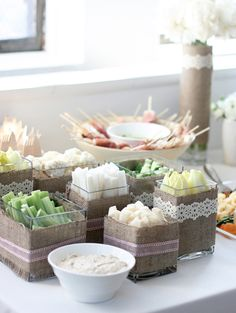 wrap containers in burlap and tie with lace ribbons