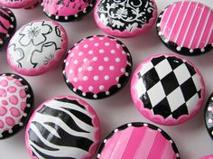 Hand painted wooden knobs - that would be a great project and we could match whatever (not to mention save a ton of $$)