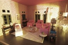 Barbie Malibu Dream House Inspiration: The bottom floor takes its inspiration from the Beverly Hills Hotel, including the hotels famous Martinique banana leaf wallpaper reproduced in 1:12 scale for the atrium and, in this room