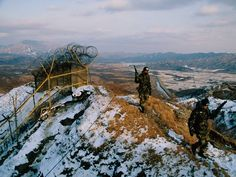 Soldiers patrol the Demilitarized Zone (DMZ), which has divided the two Koreas since the 1953 armistice that ended the Korean War. Around two million troops are stationed along the 2.5-mile-wide (4-kilometer-wide) DMZ, but the zone is off limits to nearly all humans and remains largely untouched. Conservationists say it may be Korea's greatest wildlife preserve. Photograph by Michael S. Yamashita