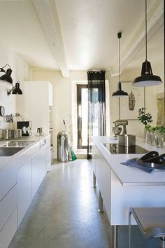 Black lamps for this white kitchen.