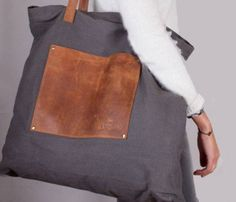 Cute tote! Love the charcoal with brown distressed leather.