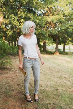 Love her style here. And her HAIR. Dif shoes though. Preferably black heeled ankle booties. Its casual but edgy----> silver bell