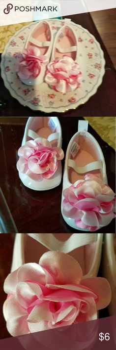 NWOT Easter Shoes! So white like patten with pretty pink roses on top! Put on our grand baby only one time for pictures. Gerber Shoes Baby & Walker