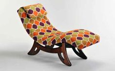Jewel Retro Chaise Lounge. Molded plywood with multilayer urethane, fire retardant foam. Exposed wood base is solid American walnut with hardwood doweled construction and finished with hand rubbed, multi layer coated lacquer.  Upholstery for this retro classic is multicolored woven polyester with a jewel pattern and comes with an adjustable head rest. The piece is reminiscent of a 60's style chaise. American Walnut, Exposed Wood, Plywood, Jewel, Hardwood, Upholstery, Rest, Lounge, Construction