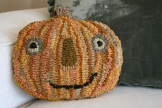 Cute pumpkin! Not sure what it's made from but could be done with seeds/beans.  A set of them would make a great Thanksgiving display (less the faces).  :)