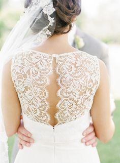 Beautiful lace, open back wedding dress: http://www.stylemepretty.com/virginia-weddings/alexandria/2014/09/25/summer-garden-wedding-at-river-farm/   Photography: Sweet Tea Photography - http://www.sweetteaphotographybylisamarie.com/