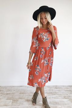 """Coral Midi Dress Floral Print + Gathered Waist Flared 3/4 Sleeve Zippered Back Model is 5'9"""" + Wearing a Small"""
