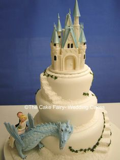 RW7 WONKY FAIRYTALE CASTLE & DRAGON  3 tier wonky fairytale cake.Sugar fairytale castle. Sugar dragon with sugar Bride and Groom in wedding attire.Cobbled effect steps and ledgesFondant ivy trails. - http://www.thecakefairy.com/www.thecakefairy.coms/info.php?p=6#