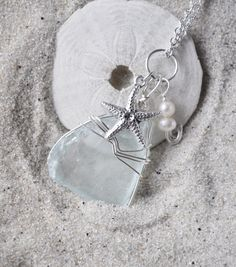 Seaglass Necklae with Starfish Charm and Pearls - Blue Seaglass Jewelry. $15.00, via Etsy.