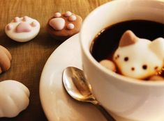 Coffee please with a delicious floating marshmallow cat and some paw prints l #cute