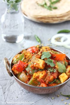"""Kadai paneer is the combination of paneer and bell peppers coated with spicy tomato sauce, aromatic spices and herbs. Kadai means """"wok. Indian Food Recipes, Asian Recipes, Ethnic Recipes, Cooking Tips, Cooking Recipes, Chilli Paneer, Punjabi Food, Spicy Tomato Sauce, Indian Curry"""