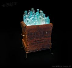 """The """"Glassket""""conceptby AfterGlow Design is an ongoing series combining containers such as crates, buckets, footlockers and cages and filling them with various aqua and clear glass containers. These bouquets of tightly arranged bottles are illuminated a bright, cool blue from below.(Avg. w:14"""" h:22"""" d:11"""") Check this other Bottle lamp:Whiskey Bottles Pulley !"""
