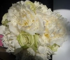 Simple white peonies, accented by green tea roses from Ecuador