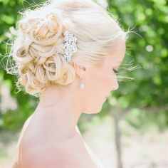 Bridal updo with jeweled comb // Clane Gessel Photography // http://www.theknot.com/weddings/album/140134
