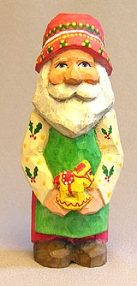 Santa with Rocking Horse Apron - Carved by Russell Scott of ScottCarvings.com